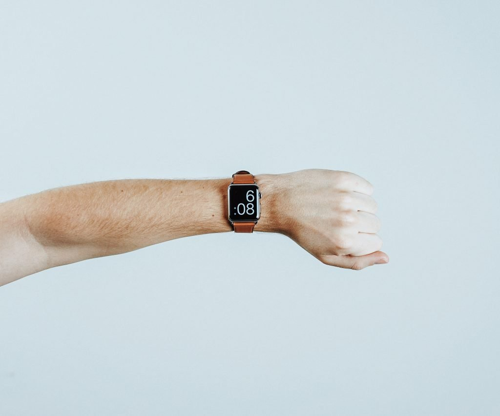 A smartwatch with a leather band.