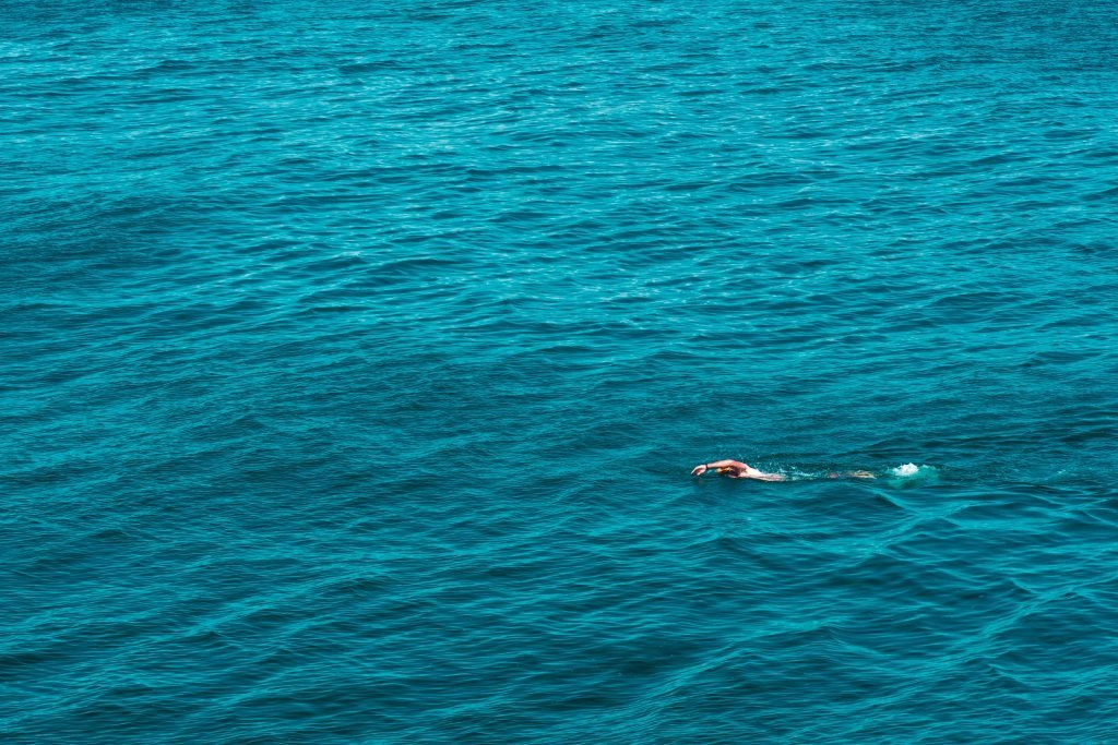 A person swimming in the ocean.