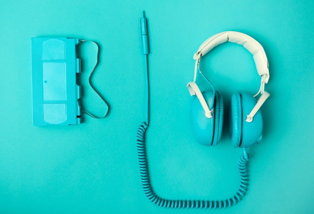 A set of blue headphones on a blue background.