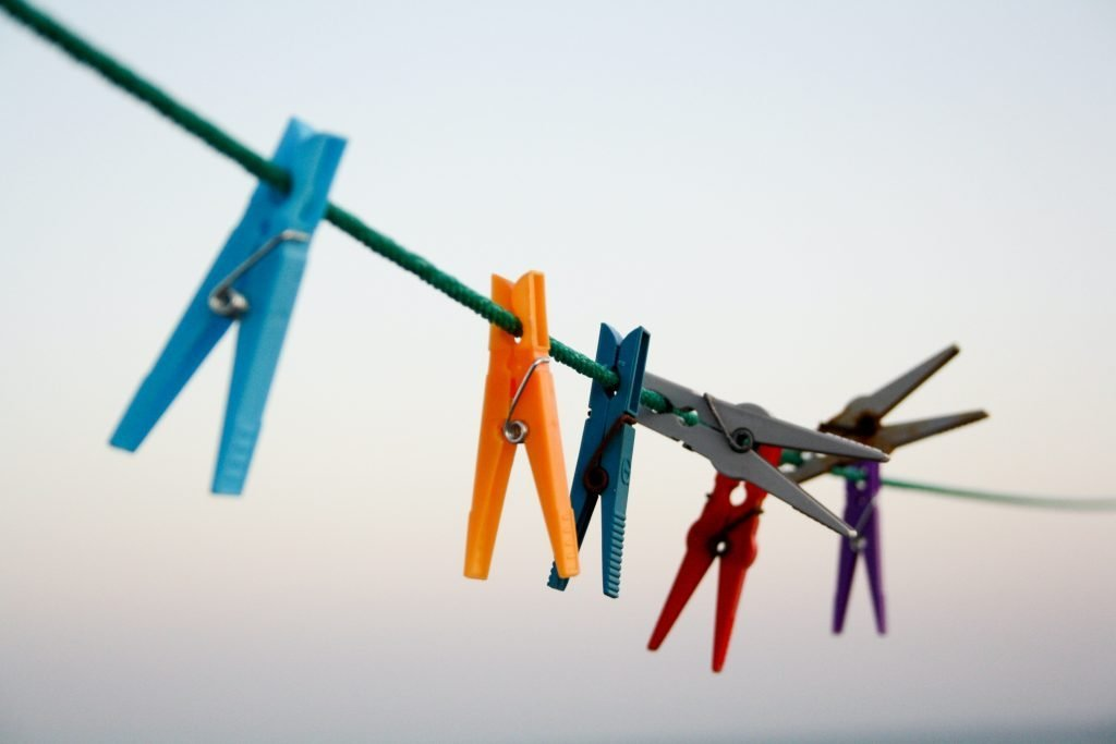 Brightly colored clothes hangers.