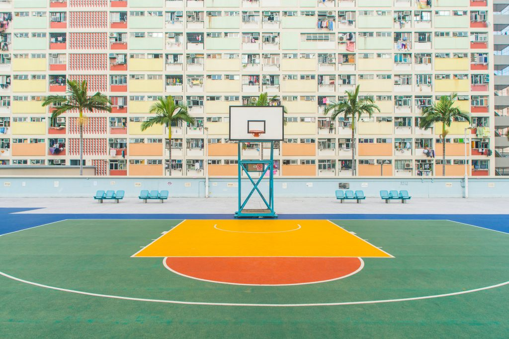 A brightly lit basketball court.
