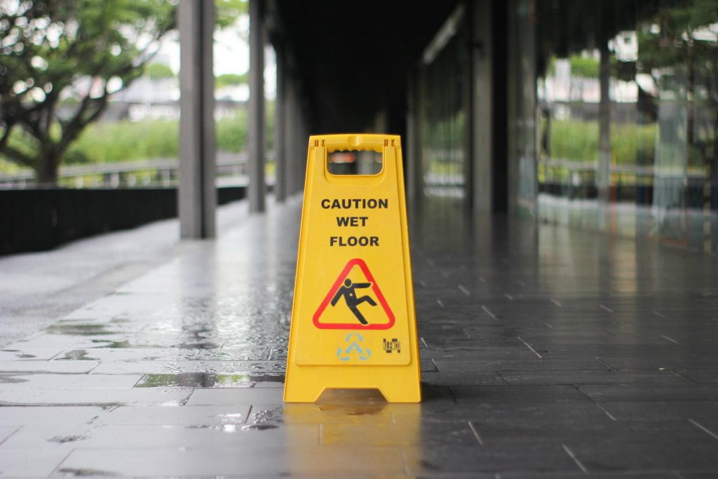 """A """"slippery when wet"""" yellow sign."""