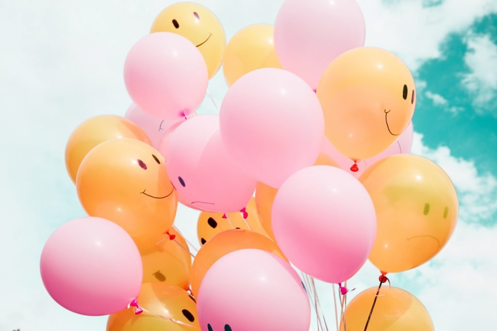 Balloons with smiley faces on them.