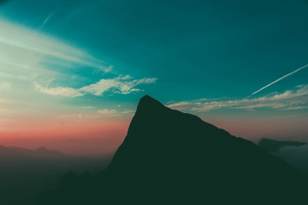 The peak of a mountain at dusk.