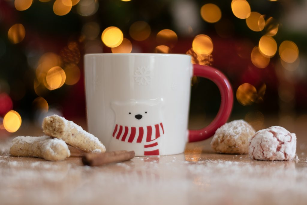 Cookies next to a mug with a polar bear on it.
