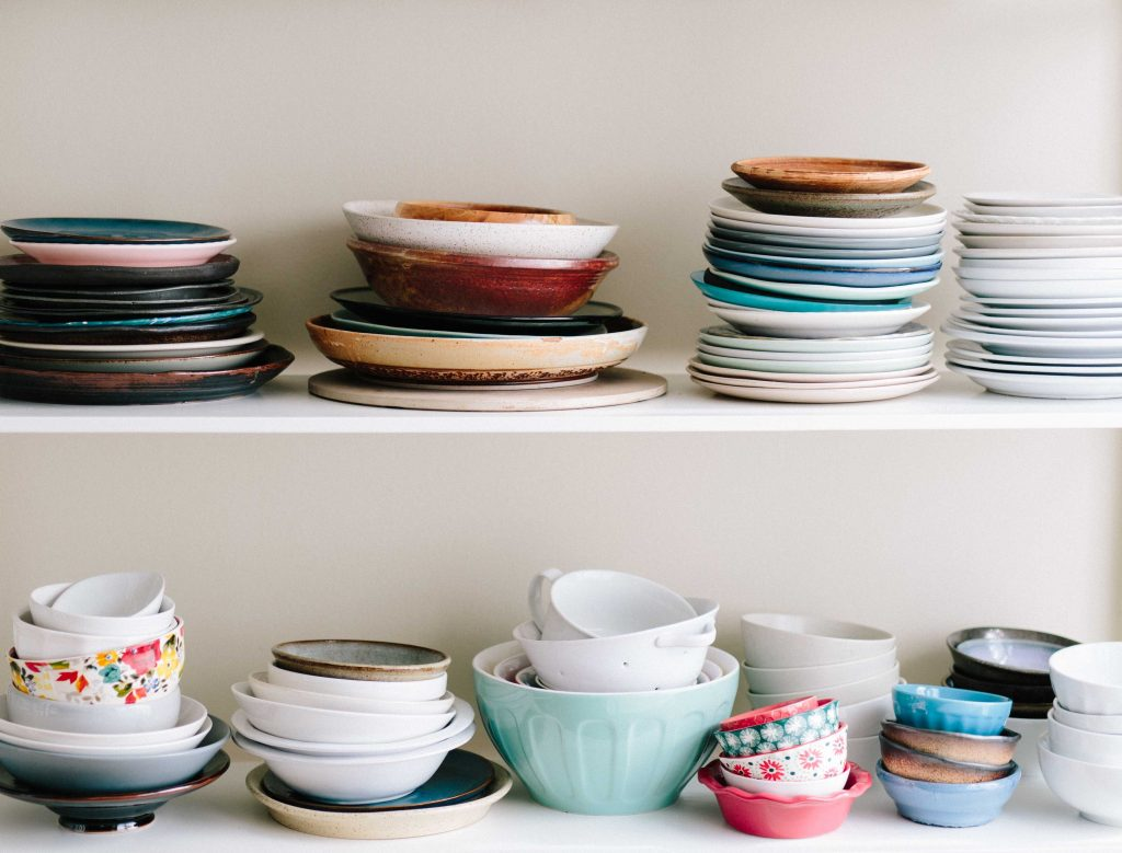 Clean dishes on a shelf.