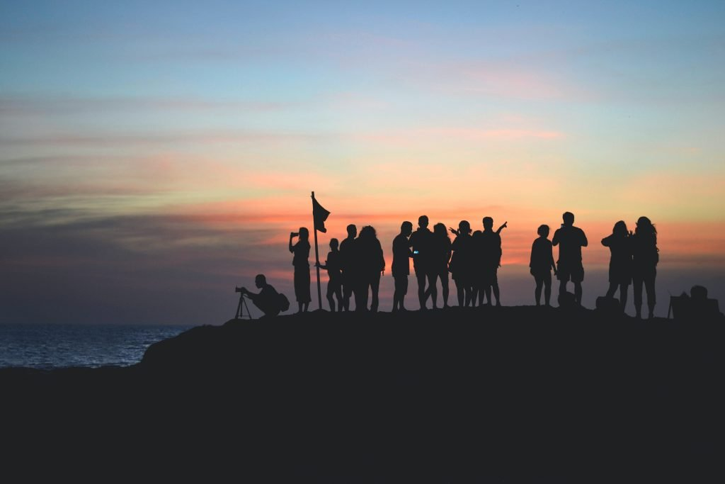 A crowd of people at sunset.