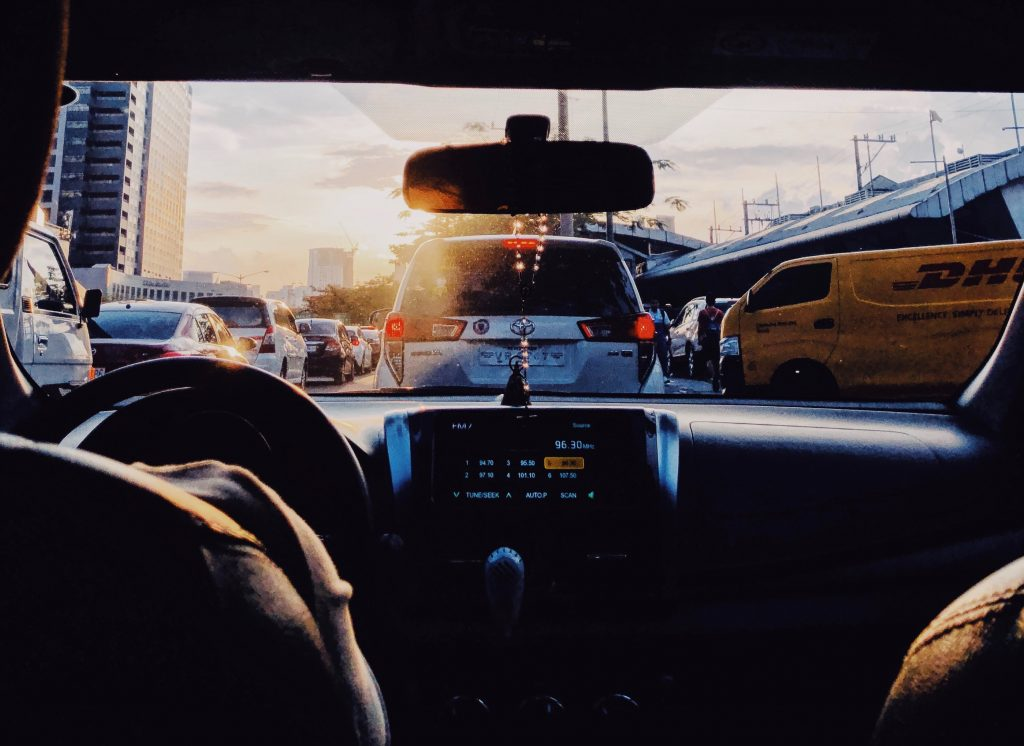 A person in a cab, sitting in traffic.