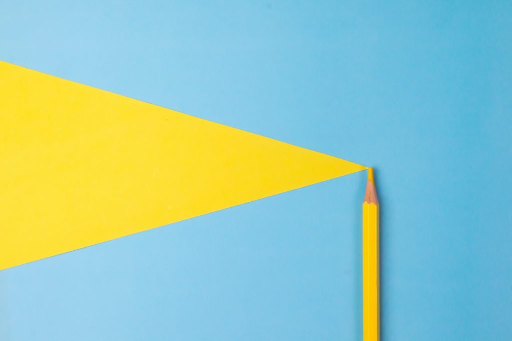 A yellow pencil on a blue background.