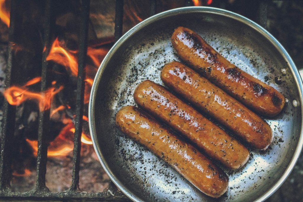 Sausage cooking in a grill.