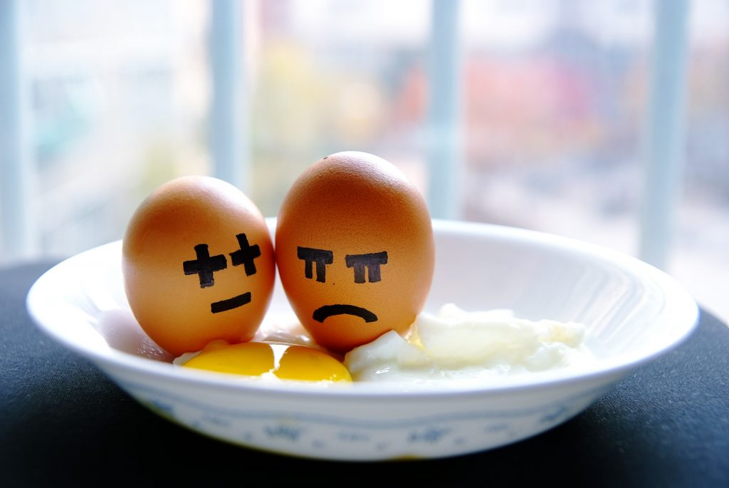 Two eggs with faces drawn on them.