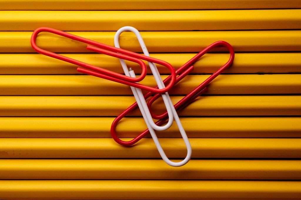 Paper clips resting on pencils.