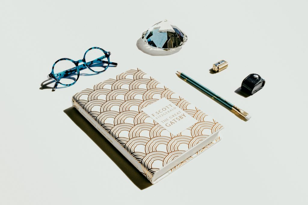 A book with a white flatlay.