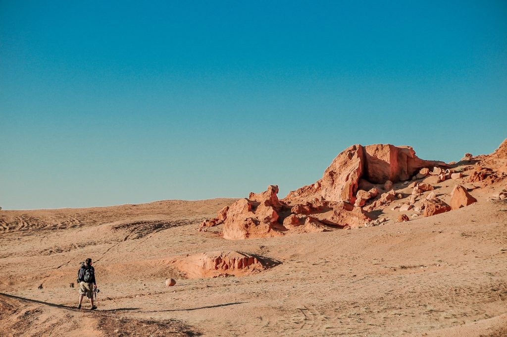 A person crossing the desert.