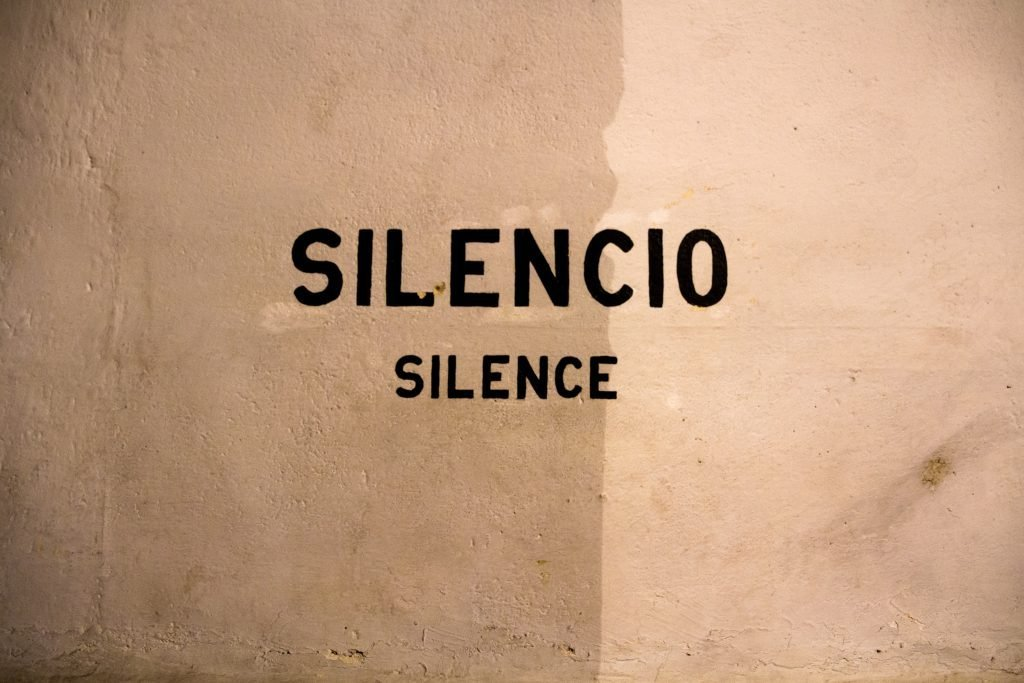 A wall that has the word Silence on it.
