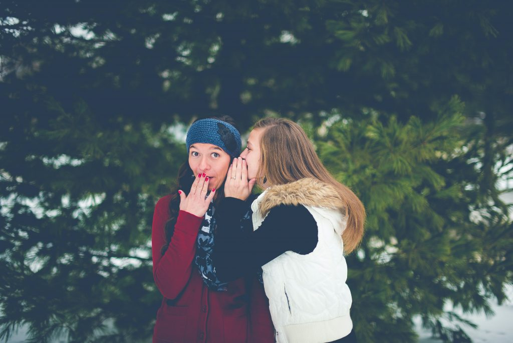 Two people sharing secrets.