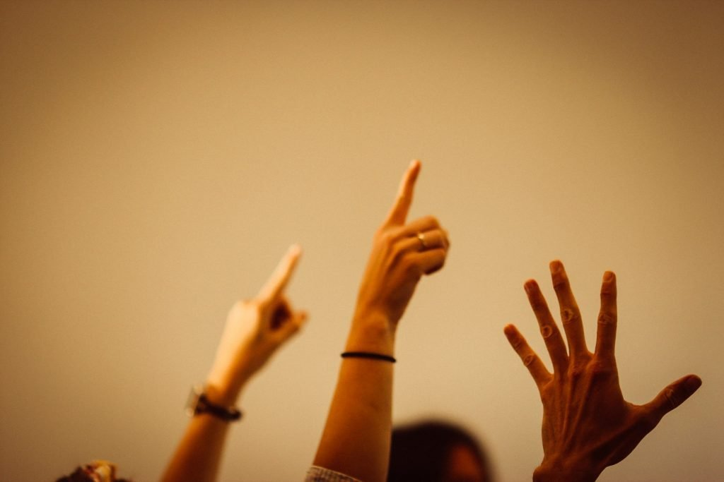 People with their fingers in the air.