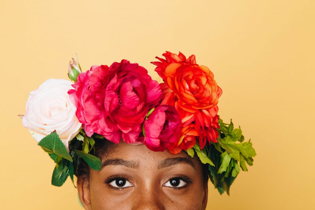 A person wearing a flower crown.