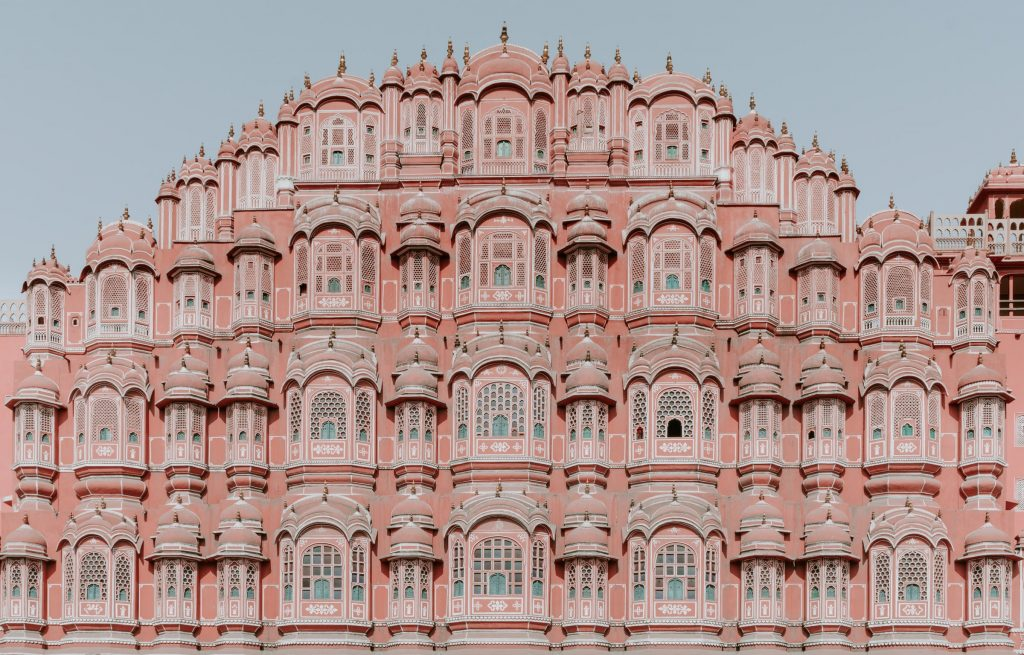 A pink building with many rooms.