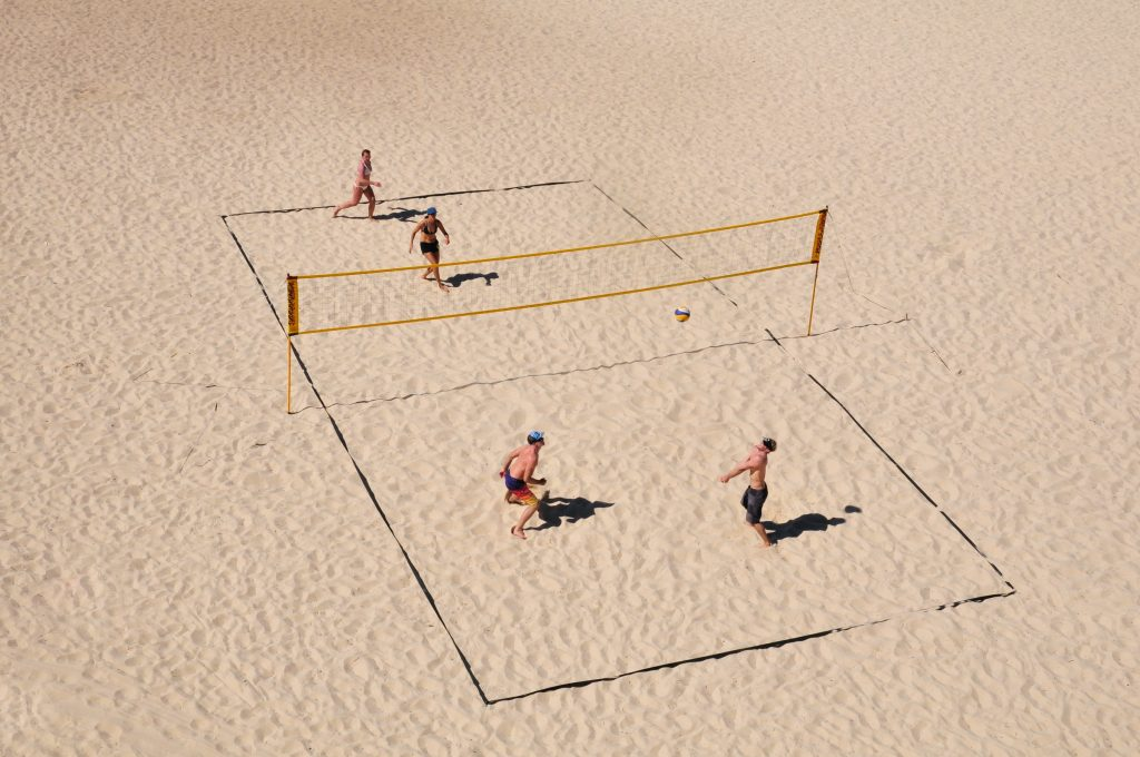 People playing sand volleyball.