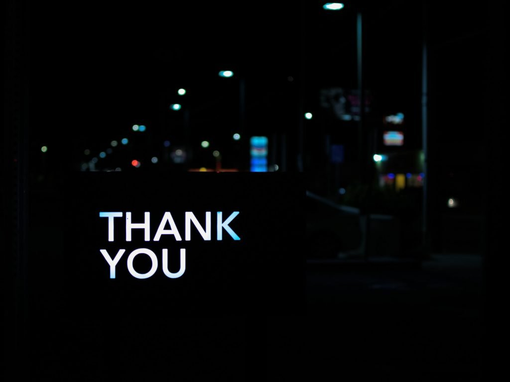 A thank you sign at night.