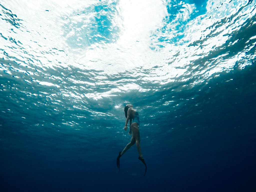 A person swimming underwater.