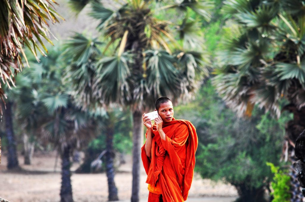 A monk on the phone.