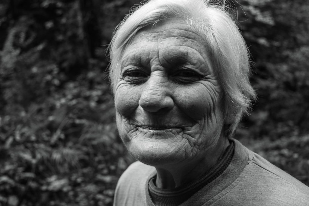 An old woman smiling.